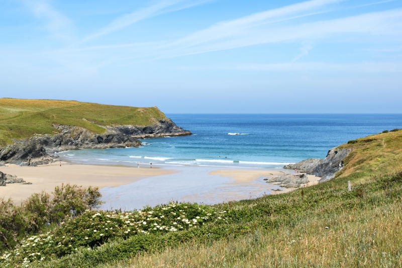 Beach and cove at Porth Joke, Pentire in Cornwall, England [Photo: Getty]