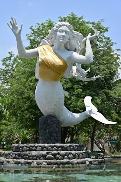One of two mermaid statues covered up at the Ancol amusement park in Jakarta