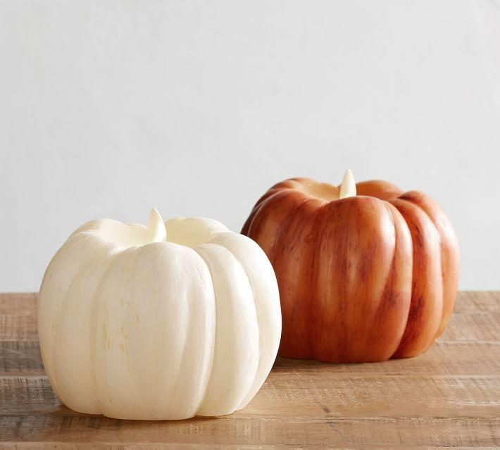"""<p><strong>See the complete Halloween Collection</strong></p><p>potterybarn.com</p><p><strong>$62.00</strong></p><p><a href=""""https://go.redirectingat.com?id=74968X1596630&url=https%3A%2F%2Fwww.potterybarn.com%2Fproducts%2Fpumpkin-premium-flicker-flameless-candle%2F&sref=https%3A%2F%2Fwww.countryliving.com%2Fdiy-crafts%2Fg2655%2Fseasonal-candles%2F"""" rel=""""nofollow noopener"""" target=""""_blank"""" data-ylk=""""slk:Shop Now"""" class=""""link rapid-noclick-resp"""">Shop Now</a></p><p>This battery-powered candle offers 500 hours of safe, flameless light.</p>"""