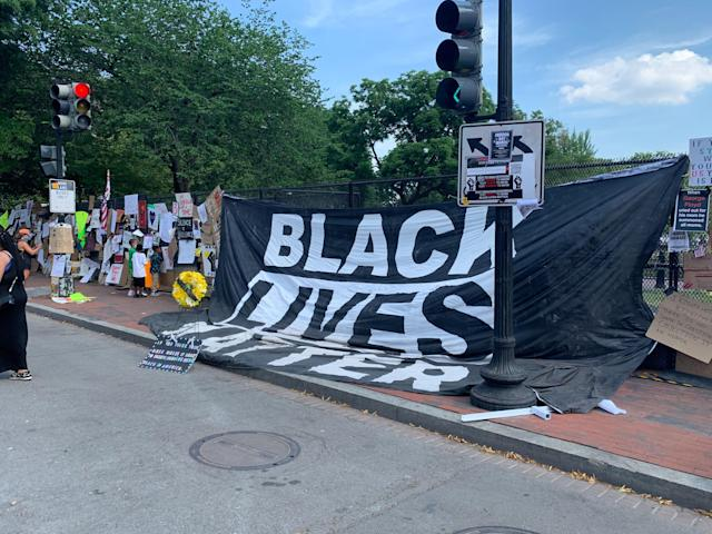 A flag attached to the fence on Lafayette Square in Washington, D.C., on Tuesday. (Brittany Shepherd)