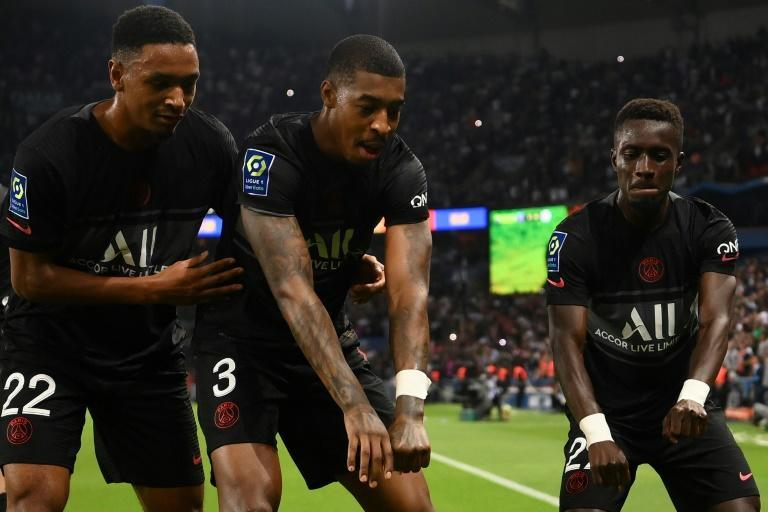 PSG players celebrate after Idrissa Gana Gueye (R) put them ahead against Montpellier (AFP/FRANCK FIFE)