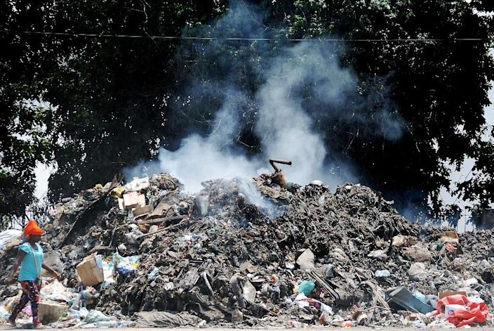 Angolans living in Luanda complain that several months worth of uncollected trash is blocking roads in the African city (AFP Photo/)