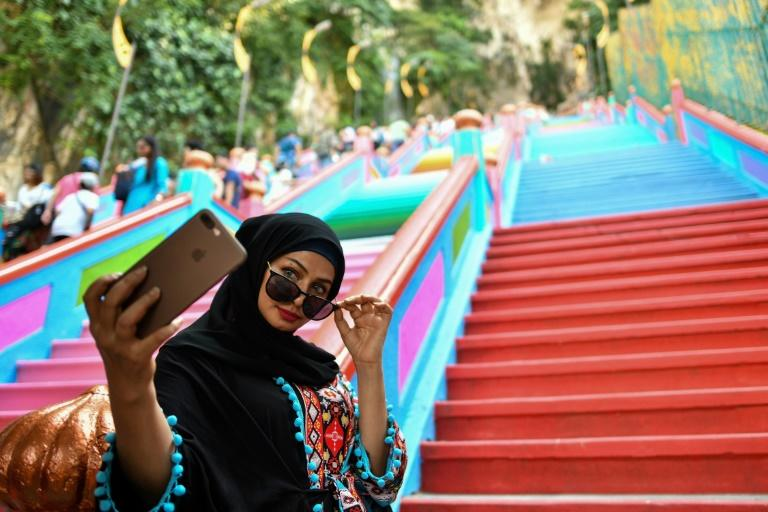 Malaysia's Batu Caves temple in Kuala Lumpur has had a controversial paint job as part of a Hindu ritual