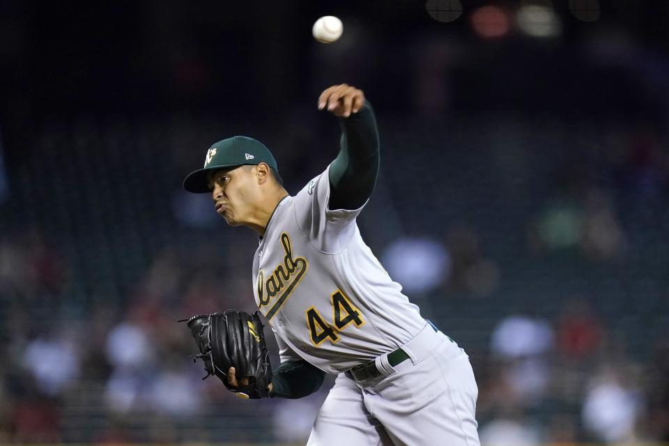 Oakland Athletics starting pitcher Jesus Luzardo throws against the Arizona Diamondbacks during the first inning of a baseball game Tuesday, April 13, 2021, in Phoenix. (AP Photo/Ross D. Franklin)