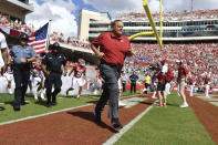 Arkansas coach Sam Pittman leads his team onto the field to play Georgia Southern during the first half of an NCAA college football game Saturday, Sept. 18, 2021, in Fayetteville, Ark. (AP Photo/Michael Woods)