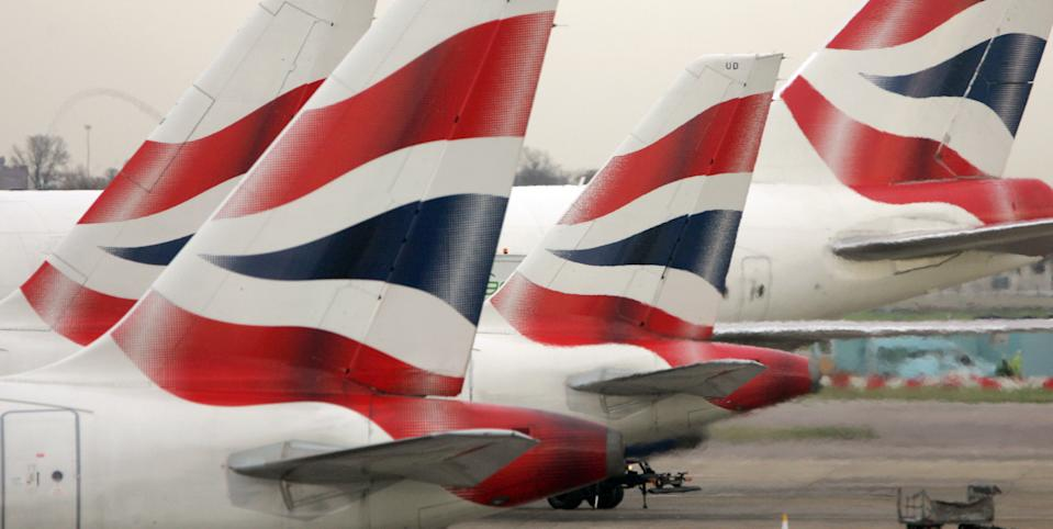 File photo dated 30/11/2006 of tail fins of British Airways' aircraft parked at Terminal One of London's Heathrow Airport. British Airways employees have overwhelmingly voted to approve a deal to furlough the airline's workers and preserve employment, a union has announced.