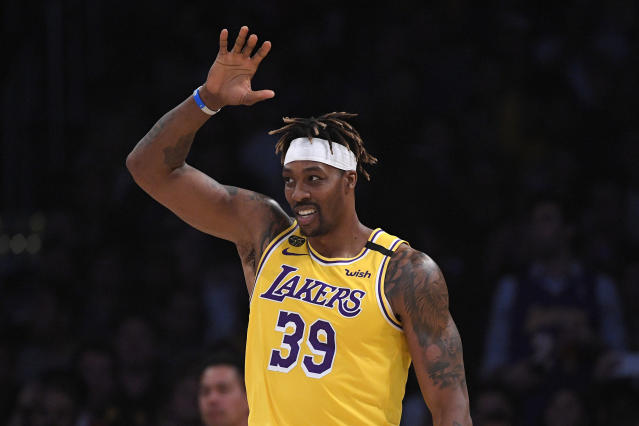 """Dwight Howard said """"somebody told on me"""" for not wearing a mask, though keeps sharing videos to social media where he's not wearing one. (AP/Mark J. Terrill)"""