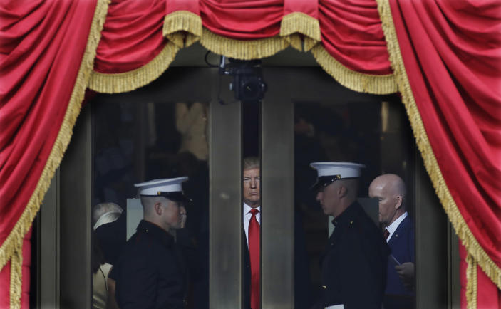<p>President-elect Donald Trump waits to stop out onto the portico for his Presidential Inauguration at the U.S. Capitol in Washington, Friday, Jan. 20, 2017. (Photo: Patrick Semansky/AP) </p>