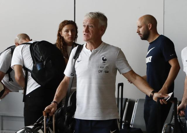 Soccer Football - World Cup - France Departure - Sheremetyevo International Airport, Moscow Region, Russia - July 16, 2018. Coach Didier Deschamps passes through a security checkpoint before the departure. REUTERS/Sergei Karpukhin