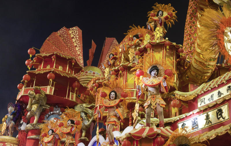 Dancers from the Dragoes da Real samba school perform on a float during a carnival parade in Sao Paulo, Brazil, early Saturday, Feb. 9, 2013. (AP Photo/Andre Penner)