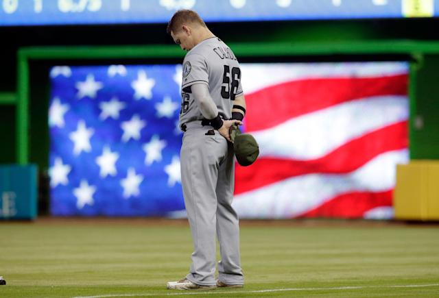 <p>Los Angeles Angels right-fielder Kole Calhoun stands for the national anthem before an interleague baseball game against the Miami Marlins on May 27, 2017, in Miami. The players wore camouflage colors to commemorate Memorial Day. (Photo: Lynne Sladky/AP) </p>