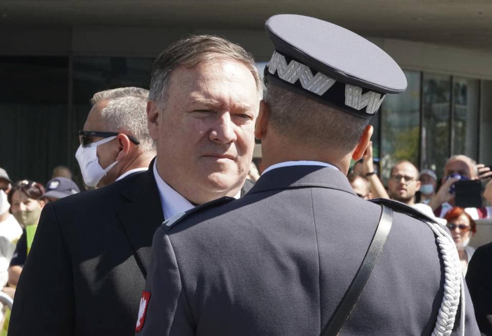 US Secretary of State Mike Pompeo talks to an officer at Pilsudski square in Warsaw, Poland, before ceremonies commemorating the 100th anniversary of the Battle of Warsaw, Saturday Aug. 15, 2020. Pompeo is on a five day visit to central Europe. (Janek Skarzynski/Pool via AP)