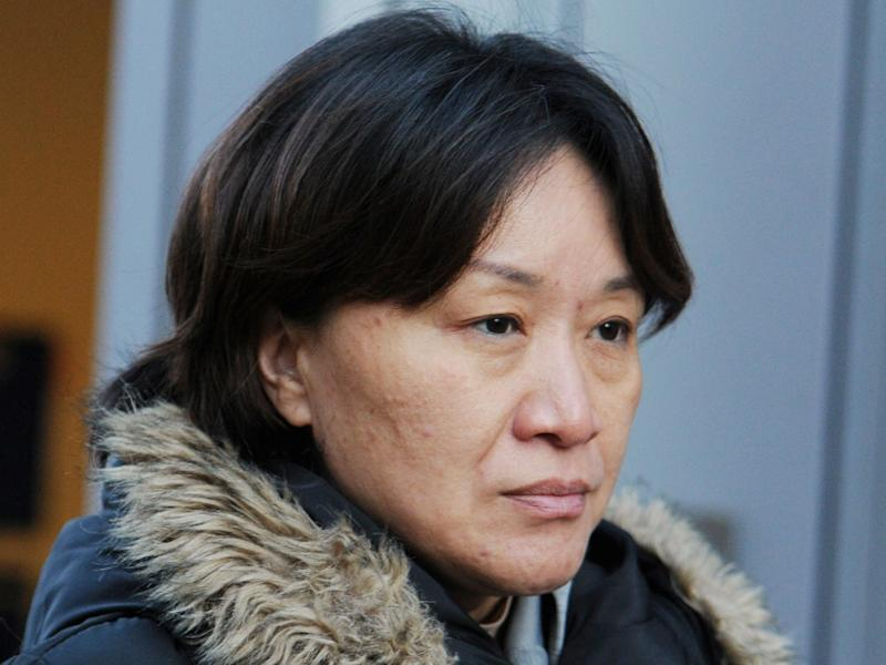 Xiaoning Sui leaves the federal courthouse after entering a plea in connection with a nationwide college admissions cheating scheme in Boston, Massachusetts, U.S., February 21, 2020..JPG