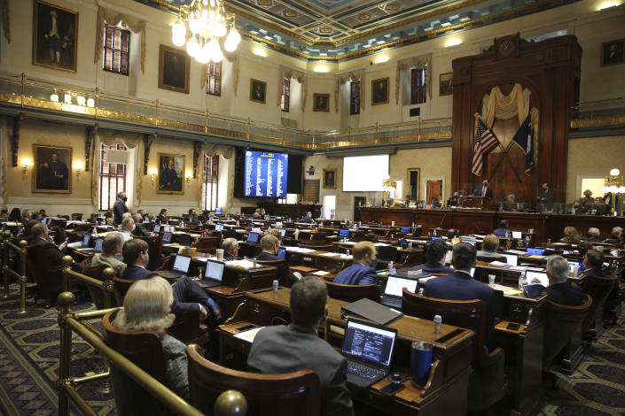 A number of empty seats are seen in the South Carolina House chamber on Wednesday, Feb. 17, 2021 in Columbia, S.C. Democrats walked out during the debate. (AP Photo/Jeffrey Collins)