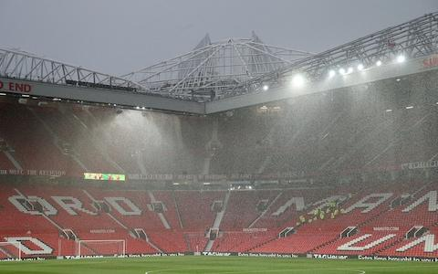 Rain falls over Old Trafford ahead of the Premier League match between Manchester United and Manchester City - Credit: Getty