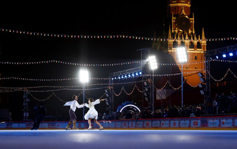 Figure skaters perform during the opening of an outdoor skating rink in the Red Square in Moscow