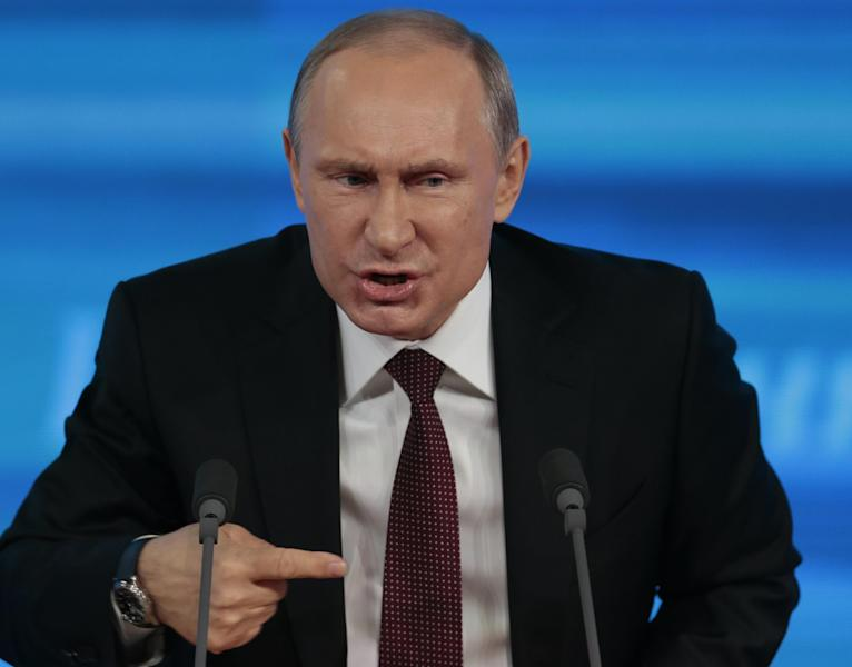 FILE - This is a Thursday, Dec. 19, 2013 file photo of Russian President Vladimir Putin gestures while speaking at his annual news conference in Moscow, Russia. Displaying the killer instincts of a chess grandmaster, Vladimir Putin rang out 2013 with an exceptional list of accomplishments. The Russian president humiliated the United States by sheltering NSA leaker Edward Snowden, brokered a Syrian chemical weapons deal that averted a seemingly inevitable U.S. military strike and outmaneuvered the 28-nation European Union in the wrestling match for influence over Ukraine. (AP Photo/Ivan Sekretarev)