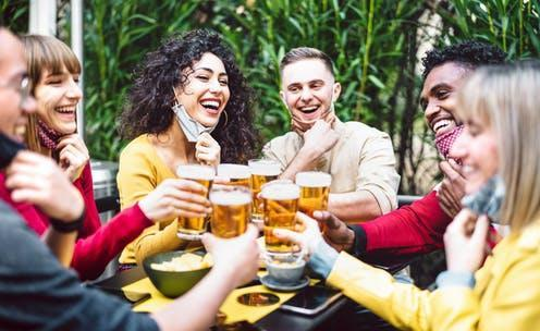 """<span class=""""caption"""">Every customer must sign in when pubs reopen.</span> <span class=""""attribution""""><a class=""""link rapid-noclick-resp"""" href=""""https://www.shutterstock.com/image-photo/young-people-toasting-beer-wearing-open-1937176303"""" rel=""""nofollow noopener"""" target=""""_blank"""" data-ylk=""""slk:View Apart/Shutterstock"""">View Apart/Shutterstock</a></span>"""