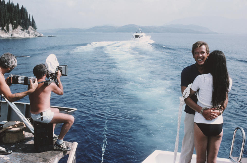 English actor Roger Moore as 007 with French actress Carole Bouquet as Melina Havelock on the set of the James Bond film 'For Your Eyes Only', February 1981. Here they are tied together in readiness for a scene in which they are dragged through shark-infested waters. (Photo by Keith Hamshere/Getty Images)