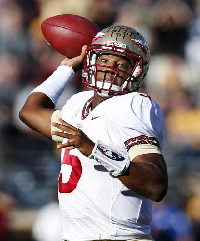 File- This Sept. 28, 2013 file photo shows Florida State quarterback Jameis Winston (5) passing the ball during the first quarter of an NCAA college football game against Boston College at Alumni Stadium in Boston. There's not an enormous difference between Winston and Tajh Boyd of Clemson. At least not to a couple of former NFL executives. Gil Brandt, former Dallas Cowboys vice president of player personnel, says the redshirt freshman Winston has a slightly stronger arm. (AP Photo/Elise Amendola, File)