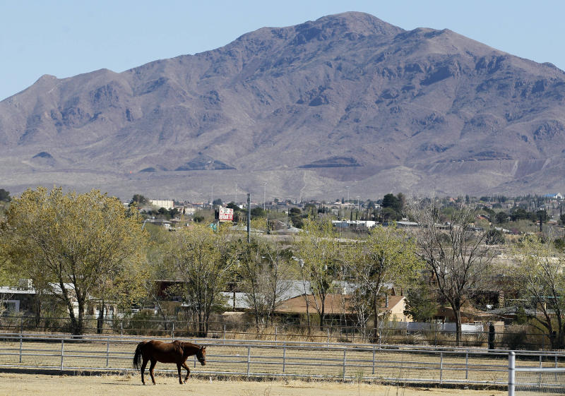 In this March 22, 2012 photo, a horse trots around a field in the early morning in Sunland Park, N.M. Scandal in this small border town is nothing new. But what is new is the harsh response: State and federal authorities are focusing on border town corruption as part of the larger effort to battle the influence of Mexican drug cartels. (AP Photo/Ross D. Franklin)