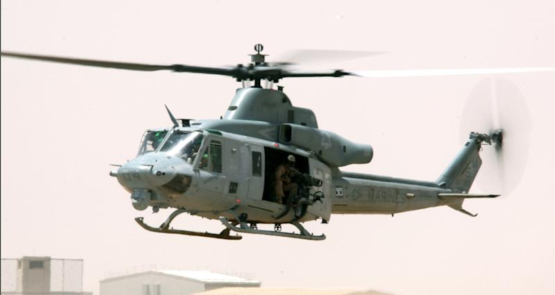 """This undated image provided by the US Marines shows a UH-1""""Huey"""" helicopter. Seven Marines were killed in a collision of two helicopters, one of them similar to this one, near Yuma, Ariz., during night training exercises, Wednesday, Feb. 22, 2012. Lt. Maureen Dooley with Miramar Air Base in California said the service members with the 3rd Marine Aircraft Wing were based at Camp Pendleton north of San Diego. The crash involved an AH-1W """"Cobra"""" and UH-1 """"Huey"""" helicopter. (AP Photo/US Marines)"""