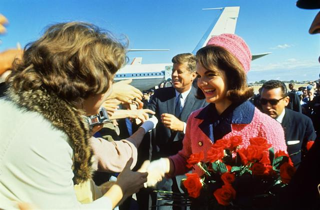 <p>President John F. Kennedy and his wife, Jacqueline, are greeted by an enthusiastic crowd upon their arrival at Dallas Love Field, Nov. 22, 1963. (Photo: Art Rickerby/The LIFE Picture Collection/Getty Images) </p>