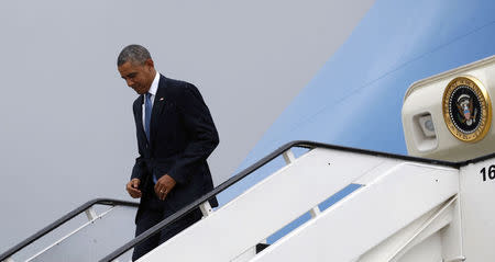 U.S. President Barack Obama steps out from Air Force One upon his arrival in Brussels June 4, 2014. Obama will attend the G7 meeting. REUTERS/Kevin Lamarque
