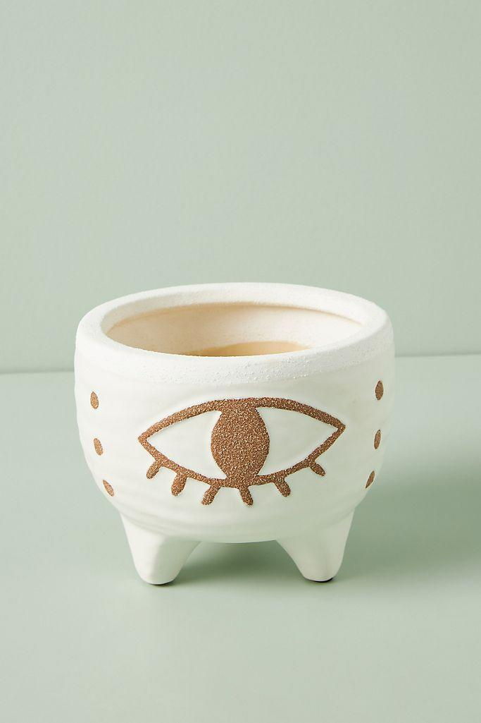 """<br><h2>Anthropologie Nazaar Footed Pot</h2><br>A chic hand-painted pot that brings style to your plant. At 5 inches tall and 6.25 inches wide, this pot is optimal for small to medium-size house plants and would look just stunning on a windowsill.<br><br><em>Shop <strong><a href=""""http://anthropologie.com"""" rel=""""nofollow noopener"""" target=""""_blank"""" data-ylk=""""slk:Anthropologie"""" class=""""link rapid-noclick-resp"""">Anthropologie</a></strong></em><br><br><strong>Anthropologie</strong> Nazaar Footed Pot, $, available at <a href=""""https://go.skimresources.com/?id=30283X879131&url=https%3A%2F%2Fwww.anthropologie.com%2Fshop%2Fnazar-footed-pot"""" rel=""""nofollow noopener"""" target=""""_blank"""" data-ylk=""""slk:Anthropologie"""" class=""""link rapid-noclick-resp"""">Anthropologie</a>"""