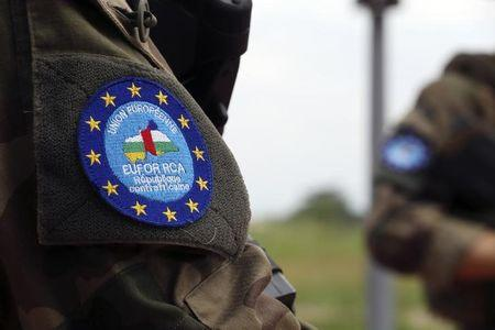 The logo of EUFOR-RCA European Union force is seen on a French soldier's uniform as they control a checkpoint at Bangui airport