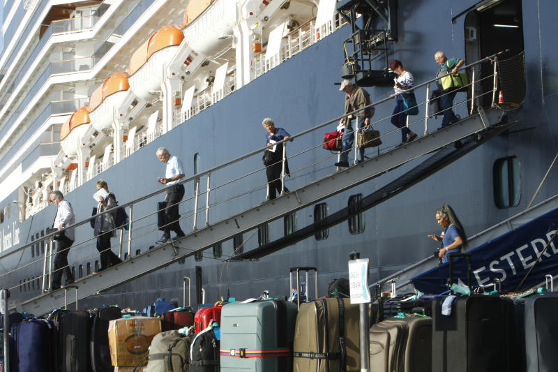 Passengers of the MS Westerdam disembark at the port of Sihanoukville in Cambodia. (AP Photo/Heng Sinith)