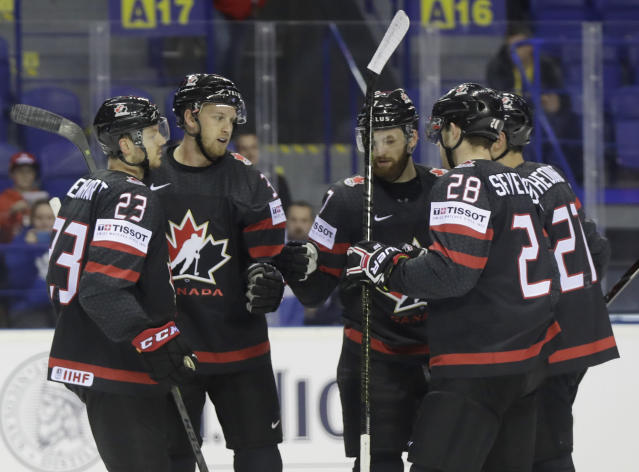 Canada's Anthony Mantha, 2nd left, celebrates with teammates after scoring his sides first goal during the Ice Hockey World Championships group A match between Canada and France at the Steel Arena in Kosice, Slovakia, Thursday, May 16, 2019. (AP Photo/Petr David Josek)