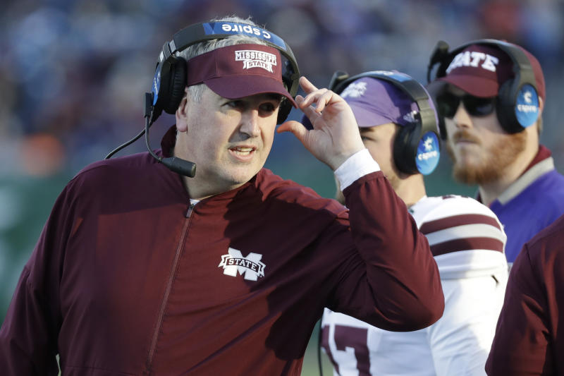 FILE - In this Dec. 30, 2019, file photo, Mississippi State head coach Joe Moorhead watches from the sideline in the first half of the Music City Bowl NCAA college football game against Louisville, in Nashville, Tenn.  Two people with knowledge of the situation say Mississippi State has fired coach Joe Moorhead after just two seasons. They spoke to The Associated Press on condition of anonymity because an announcement had not yet been made by the school. A meeting was scheduled Friday, Jan. 3, 2020, with Moorhead and athletic director John Cohen. (AP Photo/Mark Humphrey, File)