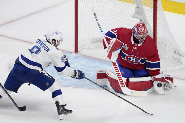 Montreal Canadiens goaltender Carey Price, right, makes a save against Tampa Bay Lightning centerTyler Johnson (9) during the second period of Game 4 of the NHL hockey Stanley Cup final in Montreal, Monday, July 5, 2021. (Paul Chiasson/The Canadian Press via AP)