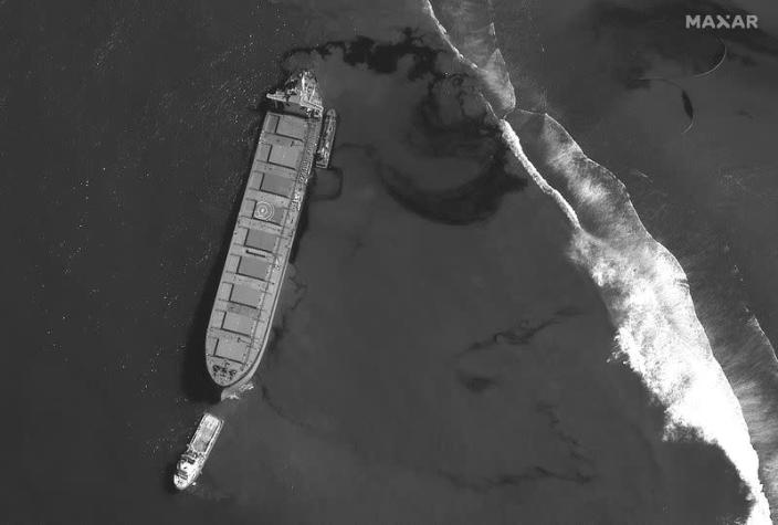 A satellite image shows the MV Wakashio ship and the oil spill off the southeast coast of Mauritius