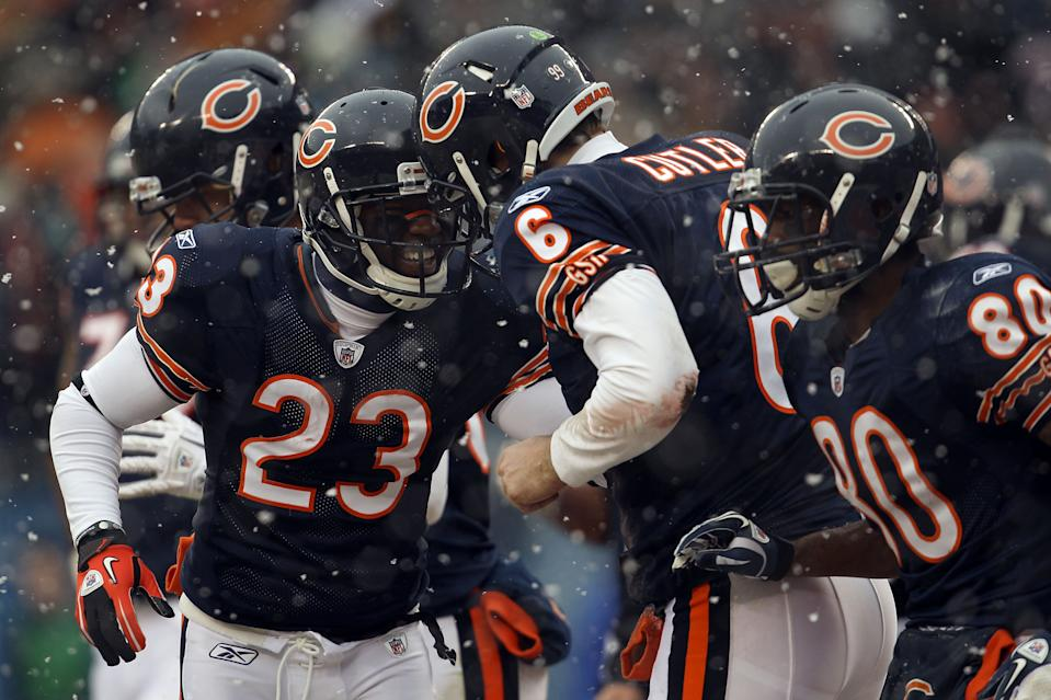 Quarterback Jay Cutler of the Chicago Bears celebrates his six-yard touchdown run with Devin Hester.