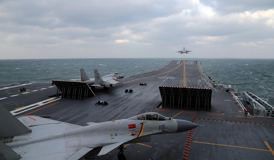 Chinese J-15 fighter jets on the deck of the Shandong's sister ship, the Liaoning. Photo: AFP
