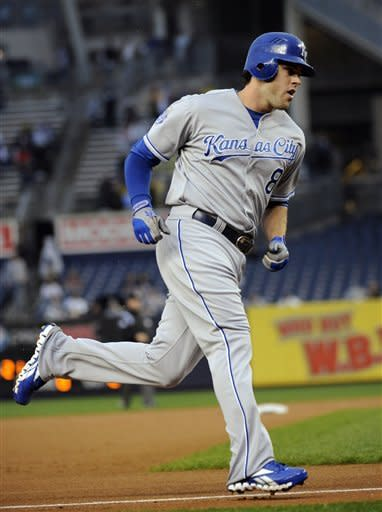 Kansas City Royals' Mike Moustakas rounds the bases after hitting a two-run home run during the first inning of a baseball game against the New York Yankees, Monday, May 21, 2012, at Yankee Stadium in New York. (AP Photo/Bill Kostroun)