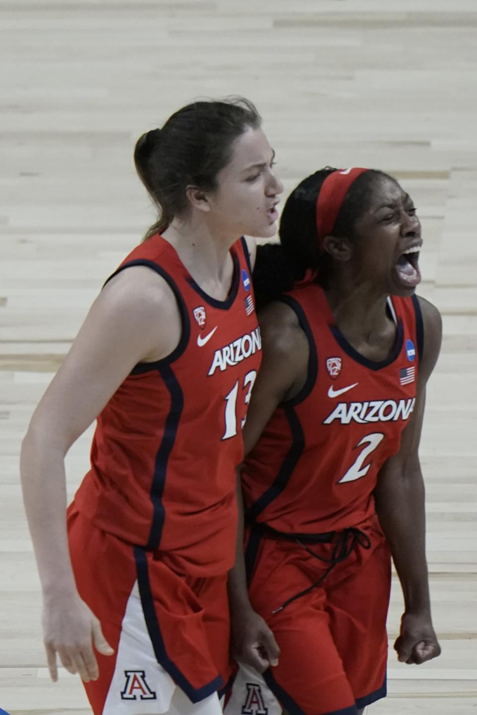Arizona's Aari McDonald (2) and Helena Pueyo celebrate during a timeout during the the second half of an NCAA college basketball game against Texas A&M in the Sweet 16 round of the Women's NCAA tournament Saturday, March 27, 2021, at the Alamodome in San Antonio. (AP Photo/Morry Gash)