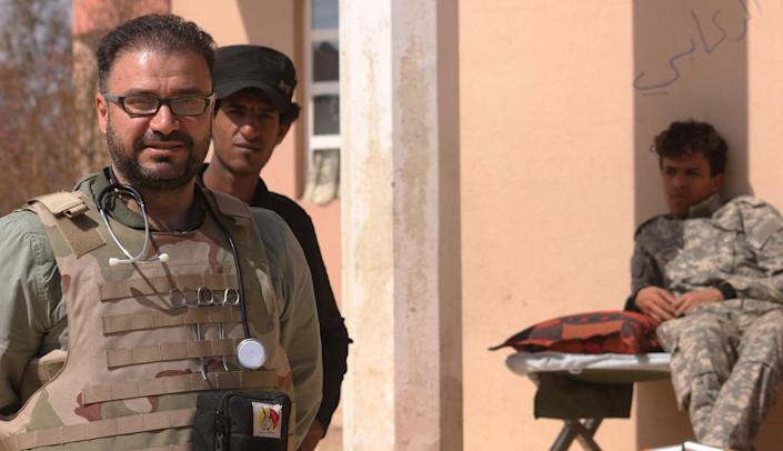 Head Doctor at the frontline clinic near Tal Afar, receiving patients, civilians and soldiers from the battlefield. (Photo: Ash Gallagher for Yahoo News)
