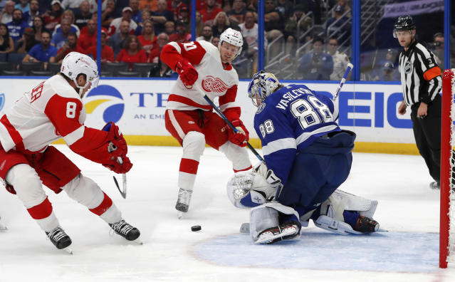 Tampa Bay Lightning's Andrei Vasilevskiy, of Russia, makes a save on a short-handed breakaway by Detroit Red Wings' Justin Abdelkader (8) and Christoffer Ehn, of Czech Republic, during the first period of an NHL hockey game Thursday, Oct. 18, 2018, in Tampa, Fla. (AP Photo/Mike Carlson)
