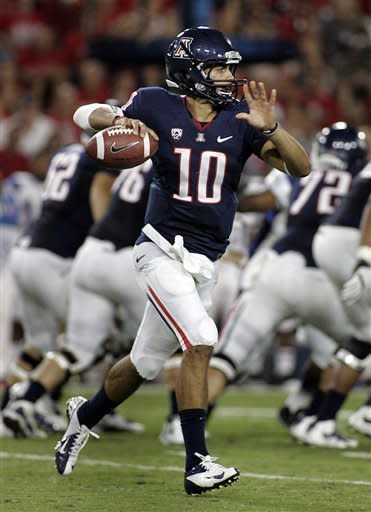 Arizona's starting quarterback Matt Scott (10) scrambles out of the pocket as he looks to pass on the run against South Carolina State during the first half of an NCAA college football game at Arizona Stadium in Tucson, Ariz., Saturday, Sept. 15, 2012. (AP Photo/John Miller)
