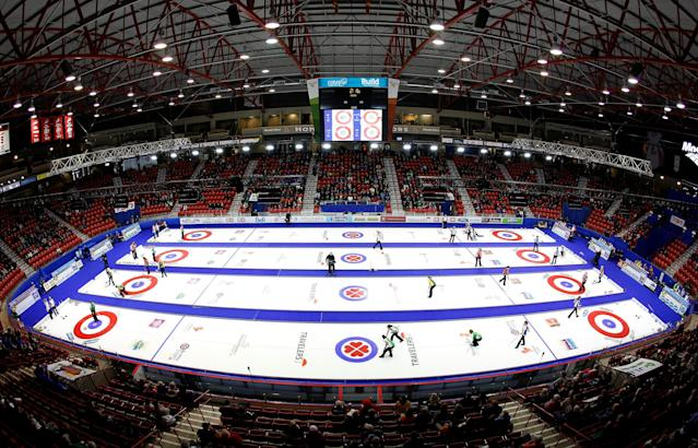 FILE PHOTO: Curlers start the first draw during the first day at Mosaic Place at the Scotties Tournament of Hearts in Moose Jaw, Saskatchewan, February 14, 2015. REUTERS/Todd Korol/File Photo