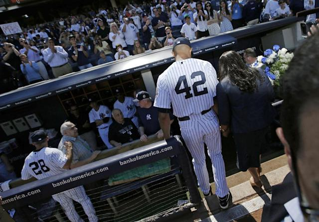 New York Yankees relief pitcher Mariano Rivera (42) walks off the field after he was honored in a pregame ceremony at Yankees Stadium before a baseball game against the San Francisco Giants, Sunday, Sept. 22, 2013, in New York. (AP Photo/Kathy Willens)