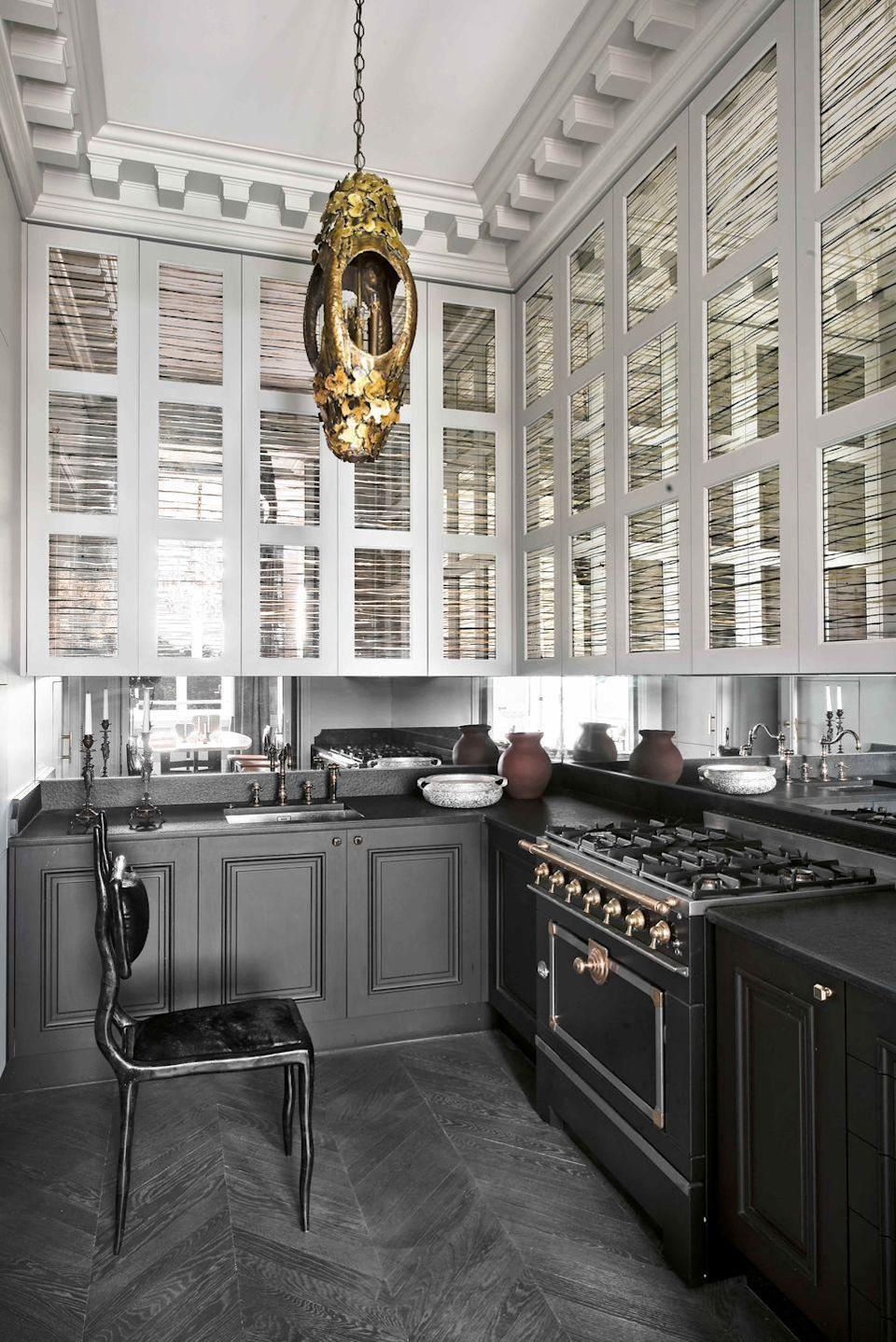 "<p>Soft, smoky tones lend high-fashion, sophisticated touch to the alluring kitchen of this <a href=""https://www.veranda.com/home-decorators/a30145127/jean-louis-deniot-paris-flat/"" rel=""nofollow noopener"" target=""_blank"" data-ylk=""slk:18th-century flat in Paris"" class=""link rapid-noclick-resp"">18th-century flat in Paris</a>. The upper cabinets feature mirrored eglomise facings and ""almost look like venetian blinds,"" notes decorator <a href=""http://www.deniot.com/"" rel=""nofollow noopener"" target=""_blank"" data-ylk=""slk:Jean-Louis Deniot"" class=""link rapid-noclick-resp"">Jean-Louis Deniot</a>. The lower cabinetry paint color is Midnight Oil by Benjamin Moore.</p><p><a class=""link rapid-noclick-resp"" href=""https://www.benjaminmoore.com/en-us/color-overview/find-your-color/color/1631/midnight-oil?color=1631"" rel=""nofollow noopener"" target=""_blank"" data-ylk=""slk:Get the Look"">Get the Look</a></p>"