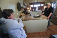 In this April 8, 2019, photo Chuck Pope, right, and wife Nina talk about his ongoing battle with rheumatoid arthritis and trying to afford medications to alleviate the condition while at their home in Derry, Pa. While he was still working, his insurance covered an injected drug that relieves pain and stops irreversible joint damage but retails for over $5,000 a month. Now his Medicare plan doesn't cover the drug, and Pope says his condition is deteriorating without it. Meanwhile, sales of approved, cheaper versions have been blocked. (AP Photo/Keith Srakocic)