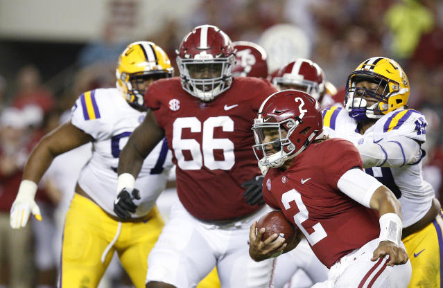 Alabama quarterback Jalen Hurts runs the ball during the first half of an NCAA college football game against LSU, Saturday, Nov. 4, 2017, in Tuscaloosa, Ala. (AP Photo/Brynn Anderson)