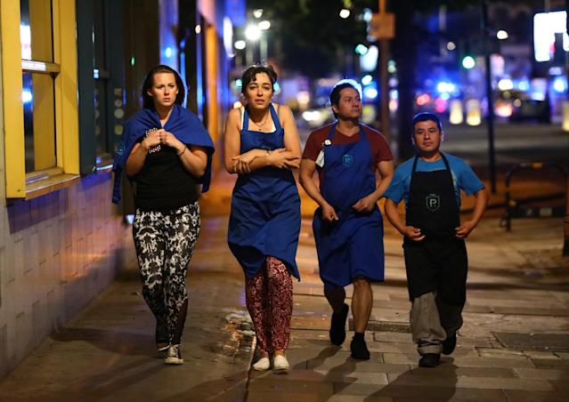 <p>People leave the area after an incident near London Bridge in London, Britain June 4, 2017 (Neil Hall/Reuters) </p>