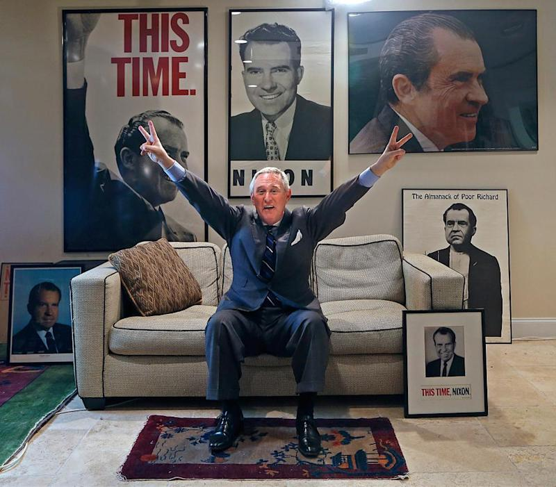 Roger Stone, pictured at his office in Fort Lauderdale, Florida, giving a very Nixonian salute.
