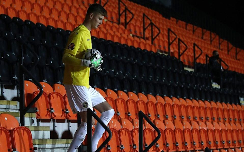 Goalkeeper Archie Mair of King's Lynn Town retrieves the ball himself to resume play during the Vananrama Conference match - Getty Images